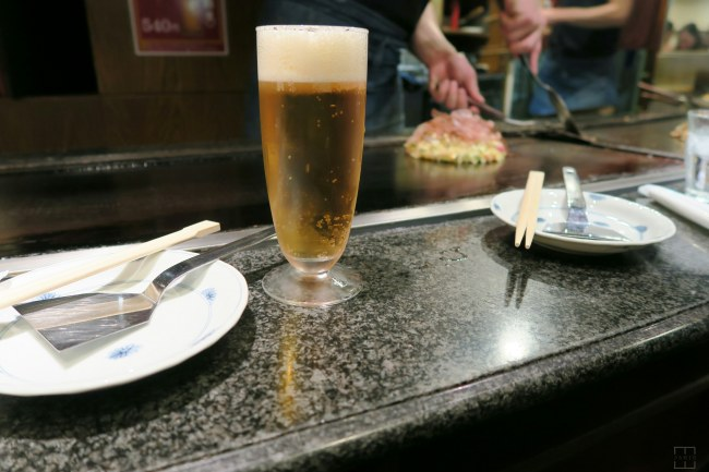 Osaka Japan. Mizuno - Having beer waiting for Okonomiyaki